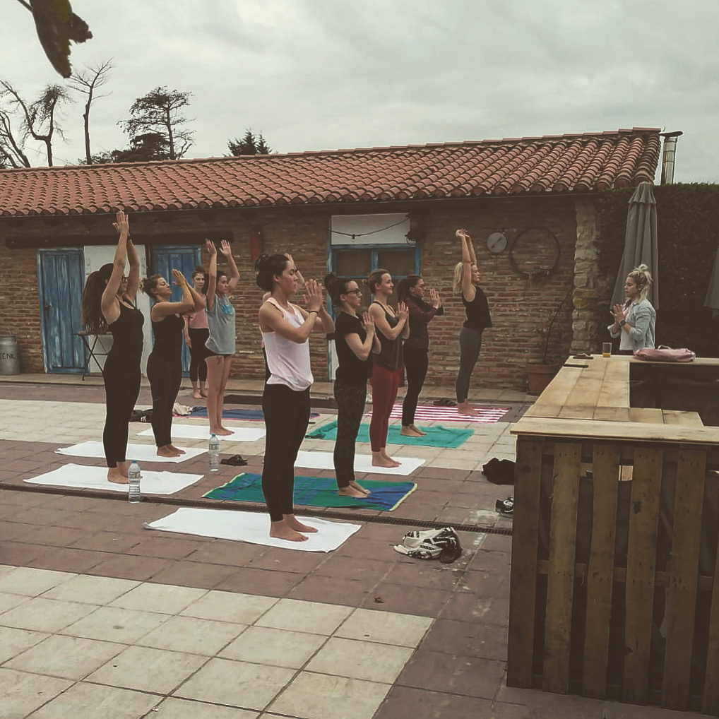Bridal party practising Yoga on the morning of the wedding